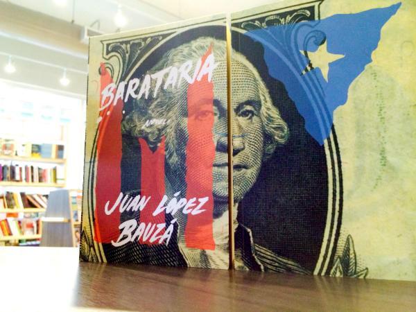 Cartel con la portada de la obra «Barataria». Foto: ©Efe/Álbum C. Campala